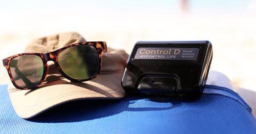 aparato-de-medir-glucosa-sobre-esterilla-de-playa